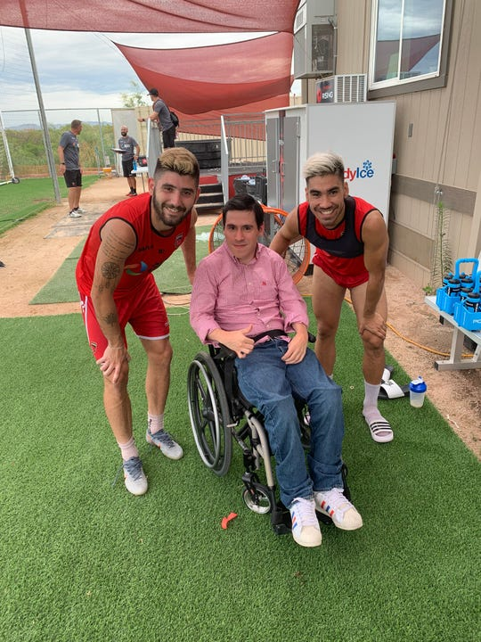 Victor Ocando (center) meets with midfielders Jon Bakero (left) and Jose Aguinaga after a Phoenix Rising FC training session earlier this month.