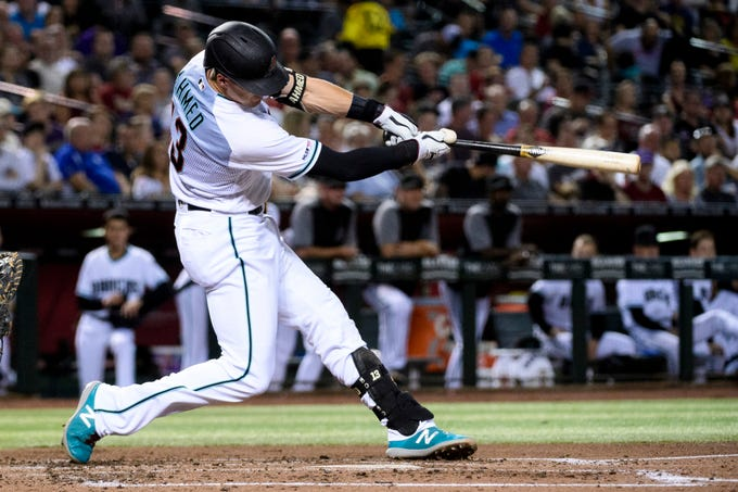 Diamondbacks shortstop Nick Ahmed hits a solo home run during the third inning of a game Aug. 20 against the Rockies at Chase Field.