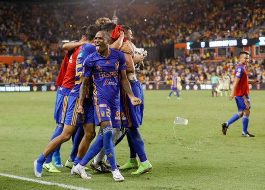 HOUSTON, TX - AUGUST 20:  Luis Quinones #23 of Tigres UANL celebrates with teammates after defeating Club America in overtime penalty kicks during the Leagues Cup semifinal match at BBVA Compass Stadium on August 20, 2019 in Houston, Texas.  (Photo by Tim Warner/Getty Images)