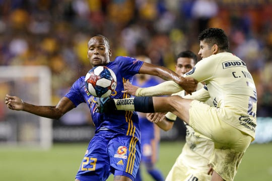 HOUSTON, TX - AUGUST 20:  Carlos Vargas #2 of Club America kicks the ball in front of Luis Quinones #23 of Tigres UANL in the second half during the Leagues Cup semifinal match at BBVA Compass Stadium on August 20, 2019 in Houston, Texas.  (Photo by Tim Warner/Getty Images)