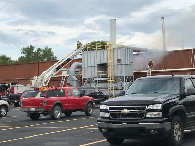 Firefighters work on a fire at Michigan Metal Coating in Port Huron on Wednesday, Aug. 21, 2019.