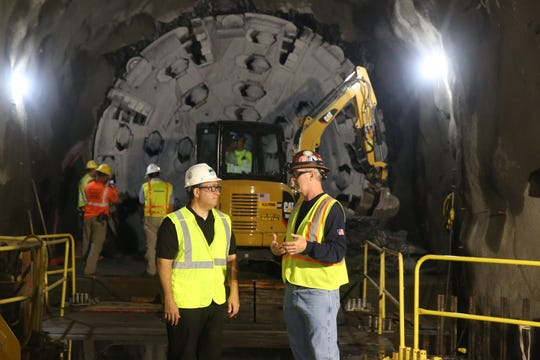 Commissioner Sapienza And Sean Mcandrew in front of the tunnel boring machine.