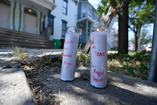 Candles have been placed in the 200 block of East Philadelphia Street in remembrance of 5-year-old Elias Dowlataram, who was fatally shot in the head while he and a 7-year-old had a gun, according to York City Police. (John A. Pavoncello photo)