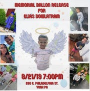 Memorial balloon release for shooting victim Elias Dowlatram.