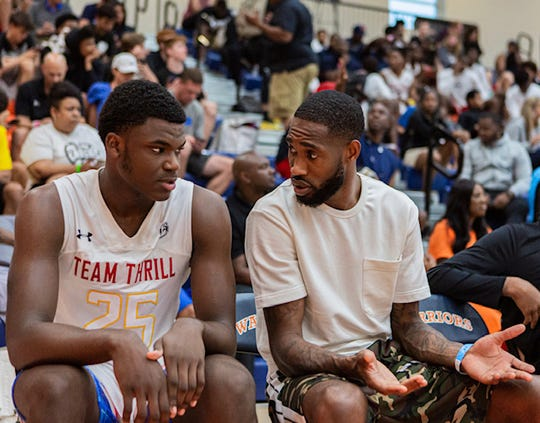 New Freedom's Jarace Walker, left, stars for one of the top AAU teams in Baltimore and the top high school basketball program in the country. He's mentored by Denver Nuggets' shooting guard Will Barton, right.