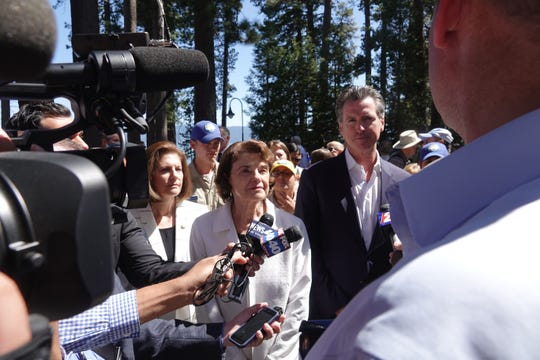 Sen. Catherine Cortez Masto, D-Nev., Sen. Dianne Feinstein, D-Calif., and California Gov. Gavin Newsom stand before reporters at the Tahoe Summit on August 20, 2019.
