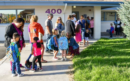 Students are comforted before the first day of school at Yerington Elementary School.
