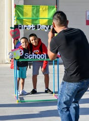 Kids have their photo taken on the first day of school at Yerington Elementary.