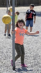 Cottonwood Elementary School students play tetherball during recess.