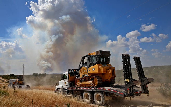 Heavy equipment is moved into position to fight the Nolke Fire, which burned approximately 3,000 acres west of San Angelo on Tuesday, August 20, 2019.