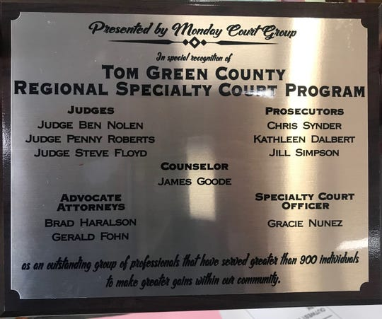 Participants and administrators with the Monday Court Group of the Regional Specialty Court Program presented Tom Green County Commissioners Court with this plaque in appreciation of their continued support during the Court's regular meeting on Tuesday, Aug. 20.