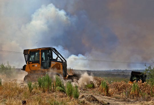 Bulldozers move into position to fight the Nolke Fire burning west of San Angelo on Tuesday, August 20, 2019.