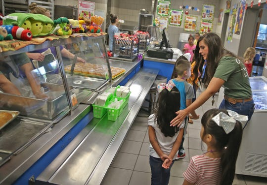 Meagan Underhill, far right, helps students with a practice run on how to navigate the lunch line on the first day of class at Goliad Elementary School on Wednesday, August 21, 2019.