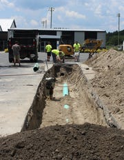 Within the last year, three washouts have occurred in the Sussex Tech high school parking lots as old terracotta drainage pipes collapsed, requiring emergency repairs. This washout began with a hole the size of a softball and led to the digging of a 170-foot-long trench to replace the pipes.