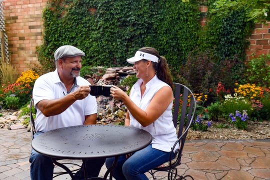 David and Victoria Obenauer make a toast to their new business, Joshua's Coffee House, on Wednesday, August 21, in Hartford.