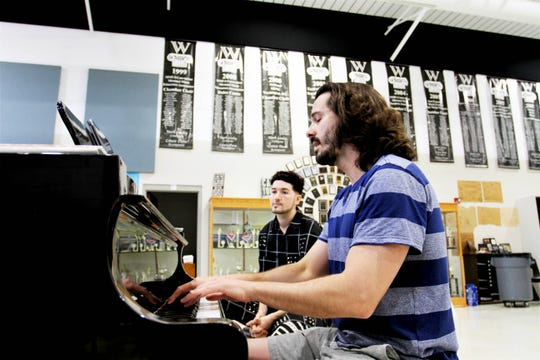 Daniel Lincoln plays piano and sings as Max Vernon watches. Both are New York City theater artists who visited the Ozarks in mid-August to work with Willard High School graduate Emalee Flatness and work on her song.