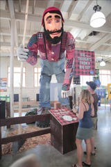 The 17-foot-tall handmade Paul Bunyan statue is currently up for auction.
