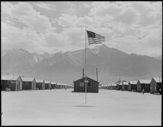 A photo depicts a dust storm at Manzanar camp in California, 1942.