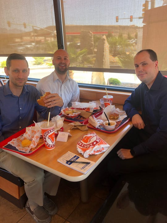A group of coworkers tries out the new chicken sandwich at Popeye's in St. George on Aug. 21, 2019.