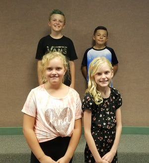 "Red Mountain Elementary students Lucas Kosidowski, back left, Carter Magalogo, back right, Bria Thompson, front left, and Parlee Stout, front right, are participants in an ""Art at Elementary School"" program."