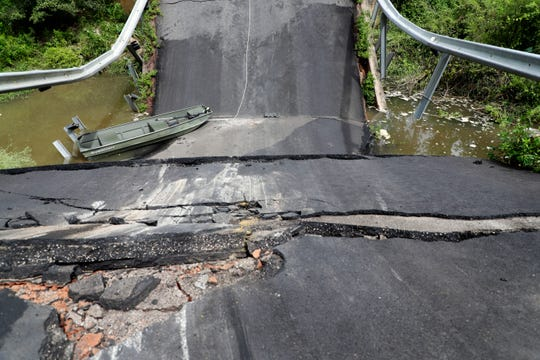A view from above of the former Hutchinson Ferry Road bridge in Gadsden County that collapsed and sent two cars airborne Wednesday, Aug. 21, 2019.