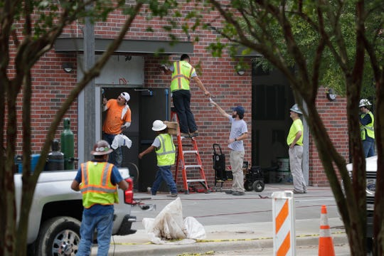 Construction crews continue work at The Standard apartment complex Tuesday, August 20, 2019. Tenants were first told they would be able to move in August 1, which then turned to August 24, just a few days from now.