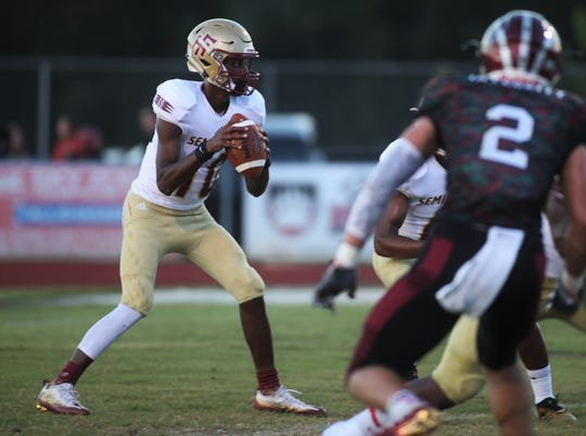 Florida High quarterback Willie Taggart Jr. looks to throw a pass during a game against Chiles last season.