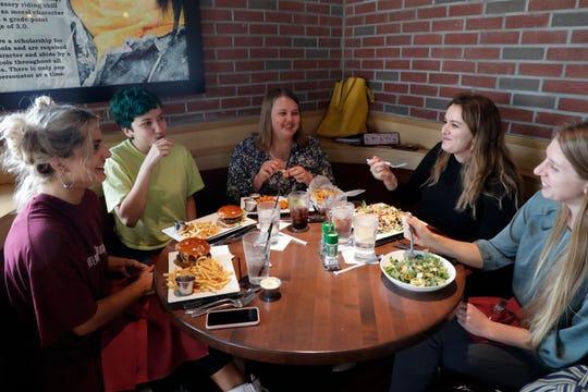 A table of Florida State University students enjoy a late lunch at Spear It: Legendary Food & Spirits Monday, August 19, 2019.