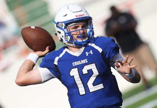 Godby senior quarterback Trey Fisher throws a pass during a spring game at Bragg Memorial Stadium.