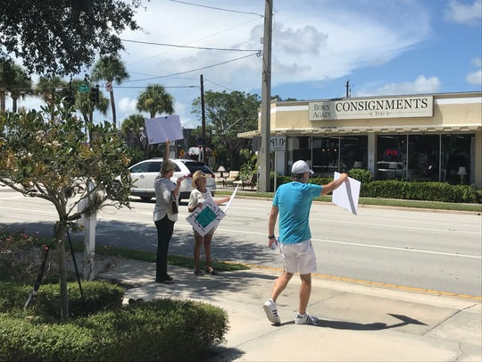 Proponents of keeping Leisure Square pool open try to get support from passing drivers before the Tuesday, Aug. 20, 2019 Vero Beach Council meeting.