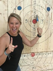 Entertainment reporter and columnist Laurie K. Blandford finally sticks an ax in the target at Axe Em in Port St. Lucie.