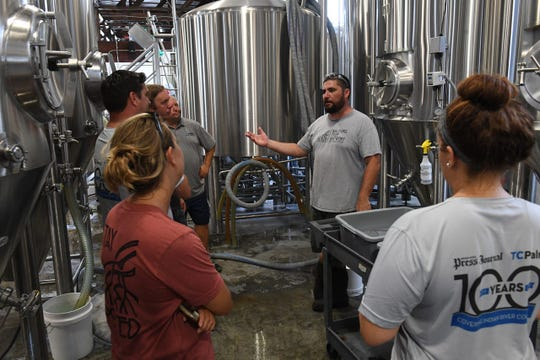 Mike Malone, co-owner ot Walking Tree Brewery discusses the steps of creating a batch of Indian River Press Journal beers for the Vero Beach Centennial at the Walking Tree Brewery.