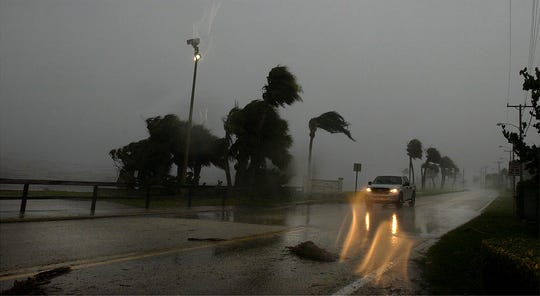 Motorists braved the hurricane force winds and heavy rain along Indian River Drive near Ocean Breeze Mobile Home Park in Jensen Beach Sept. 4, 2004, as Hurricane Frances bore down on the Treasure Coast and began to make landfall.