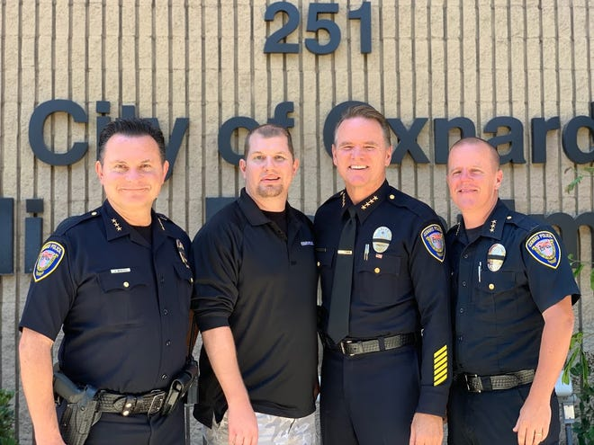 Oxnard Police Assistant Chief Jason Benites, left, poses for a photo with Officer James Langford, Police Chief Scott Whitney and Assistant Chief Eric Sonstegard during Langford's Aug. 13 retirement ceremony.