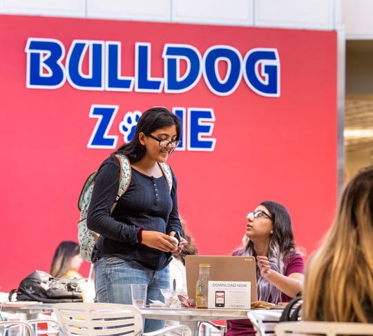 Fresno State students Genesis Chinchilla, left, and Emma Estrada chat in the University Student Union on the first day of classes on Wednesday, August 21, 2019.