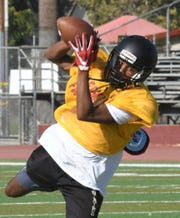 The Tulare Union High School football team practices on Aug. 20, 2019 in Tulare.