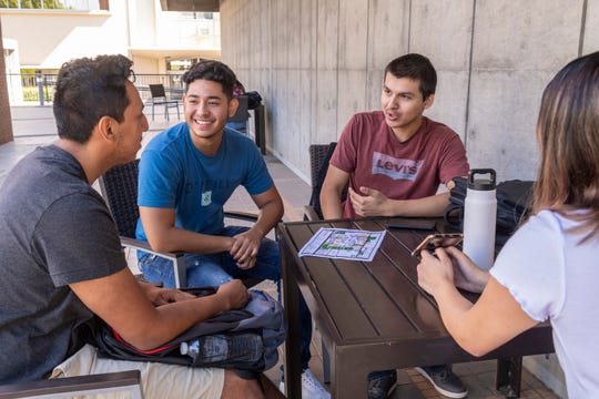 Fresno State students Brallan Pioquinto, left, Andres Virgen, Luis Mares and Kassidy Martinez hang out in the shade of the Kennel Bookstore on the first day of classes on Wednesday, August 21, 2019. Pioquinto is a Tulare Western grad, the others are Tulare Union grads.