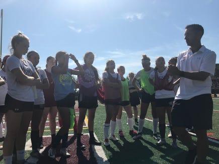 Albertus Magnus girls soccer coach Danny Samimi talks to players during a preseason practice on Aug. 20, 2019.
