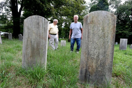 Stan Dobrinski of Sloatsburg and Bob Heddy, a former Ramapo resident, stand in an overgrown cemetery at the Gates of Praise Church Aug. 21, 2019. The men, who both have family members buried in the cemetery, say that the church has neglected to provide upkeep at the cemetery. They now want the Town of Ramapo to take care of it.