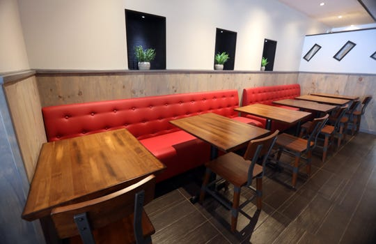 Red banquettes, part of the updated decor for all Westchester Burger Co. locations, is seen at their new location in Scarsdale Aug. 21, 2019.