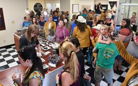Crowds poured through the doors following the ribbon cutting at the new location of B Cocoa Artisan Chocolate. The business opened Wednesday afternoon at 809 Eighth Street in the Oil & Gas Building.