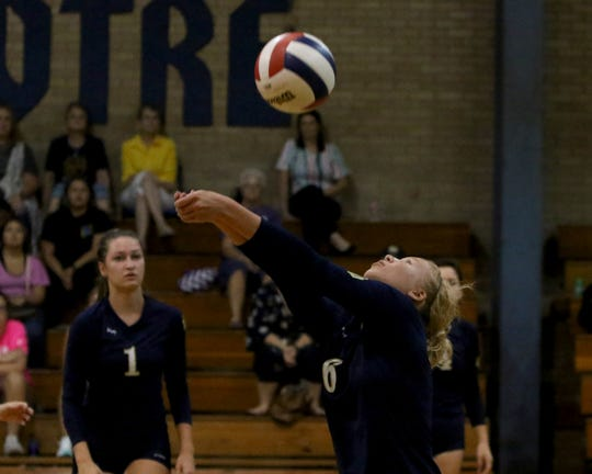 Notre Dame's Tessa Luig passes in the match against Jacksboro Tuesday, Aug. 20, 2019, in Notre Dame.