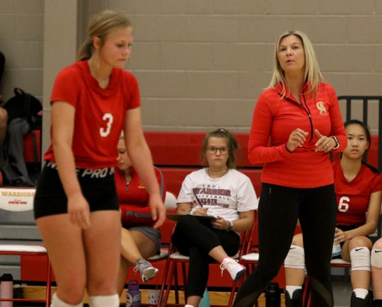 Christ Academy head volleyball coach Sara Lindemann talks to her players in the match against Petrolia Tuesday, Aug. 20, 2019, at Christ Academy.