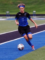 Zanesville's Evan Dinan dribbles the ball against River View during their match on Tuesday at John D. Sulsberger Memorial Stadium. The game was suspended at 2 late in the first half due to lightning and will resume on Sept. 12.