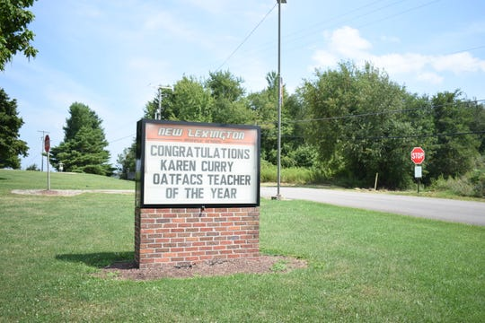 The sign outside New Lexington Middle School congratulates Curry on winning OATFACS Teacher of the Year.