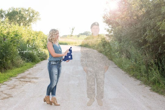 Nebraska High School Seniors Julia Yllescas is pictured with an image of her father, Army Capt. Robert J. Yllescas, who died in 2008.
