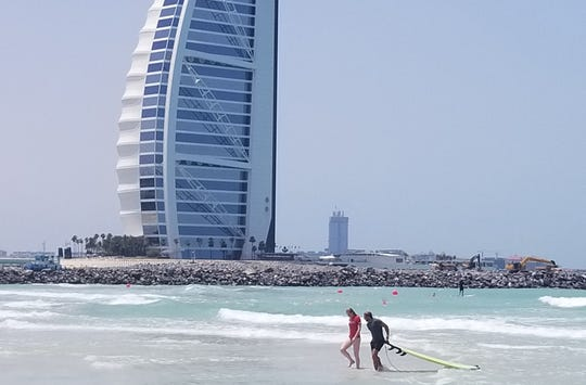 It's not the relatively modest waves that make that makes surfing in Dubai so memorable. It's the setting.