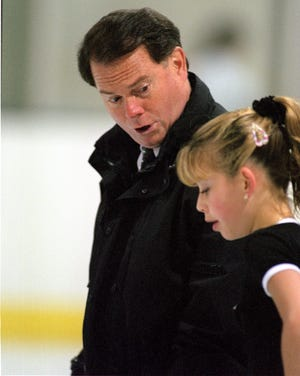 Richard Callaghan, shown in 1997 working with Tara Lipinski, was banned by the U.S. Center for SafeSport in 2019.