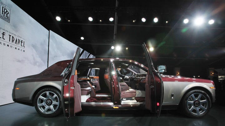 """The Rolls-Royce Pinnacle Travel Phantom car is on display at the launch ceremony of their new Pinnacle Travel Phantom in Beijing on April 18, 2014, ahead of the """"Auto China 2014"""" Beijing Automotive Exhibition."""