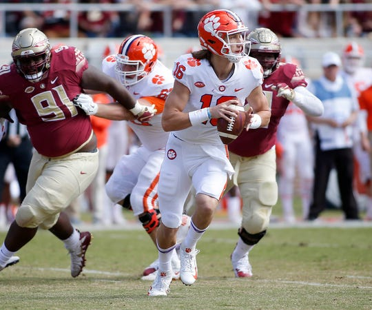 Clemson quarterback Trevor Lawrence drops back to pass against Florida State during their game in 2018.
